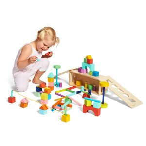 Toddler playing with The Block Set by Lovevery