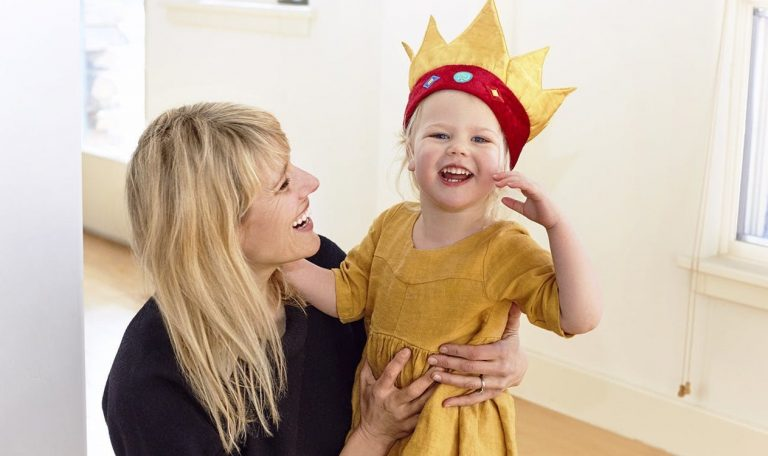 Jessica Rolph, Co-founder and CEO of Lovevery, hugging her daughter who is wearing a crown