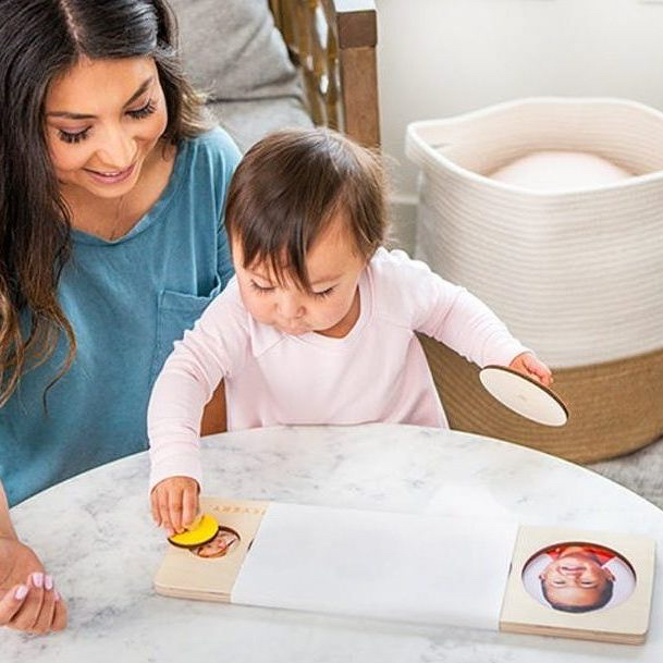 Woman and toddler playing with the Circle of Friends Puzzle by Lovevery