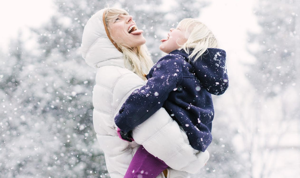 Jessica Rolph, Co-founder and CEO of Lovevery, holding her daughter outside in the snow