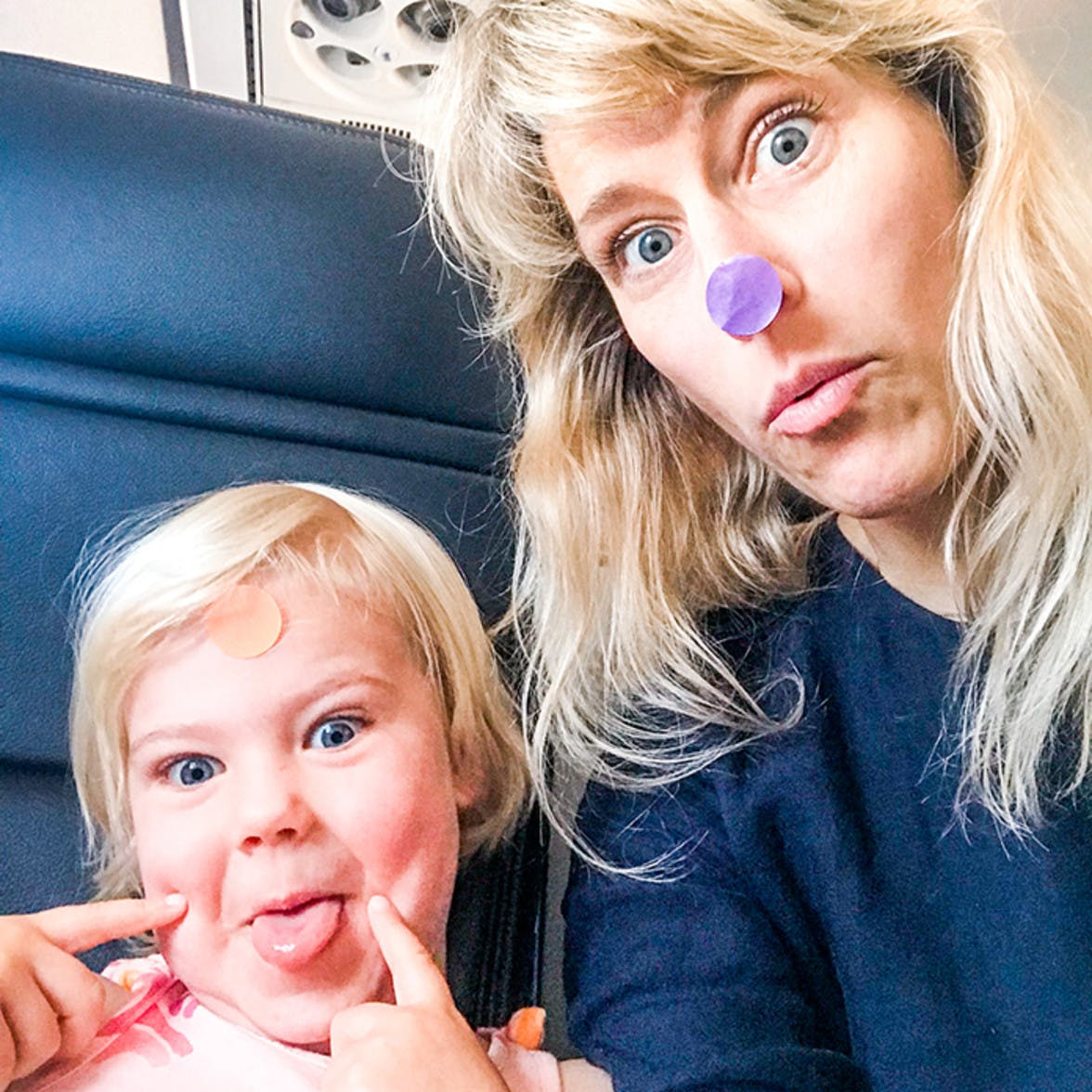 Mother and daughter with dot stickers on their face