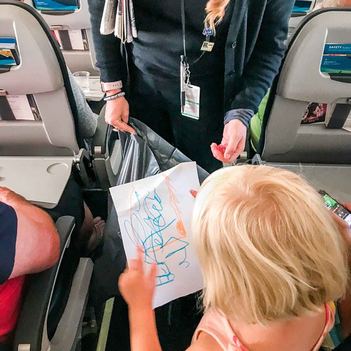 Child talking to the flight attendant in an air plane