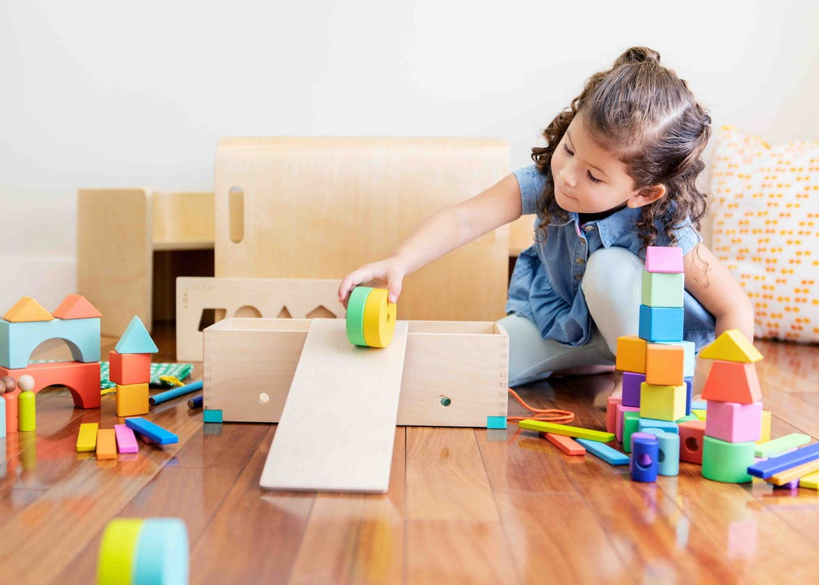 Young child playing with the Block Set by Lovevery