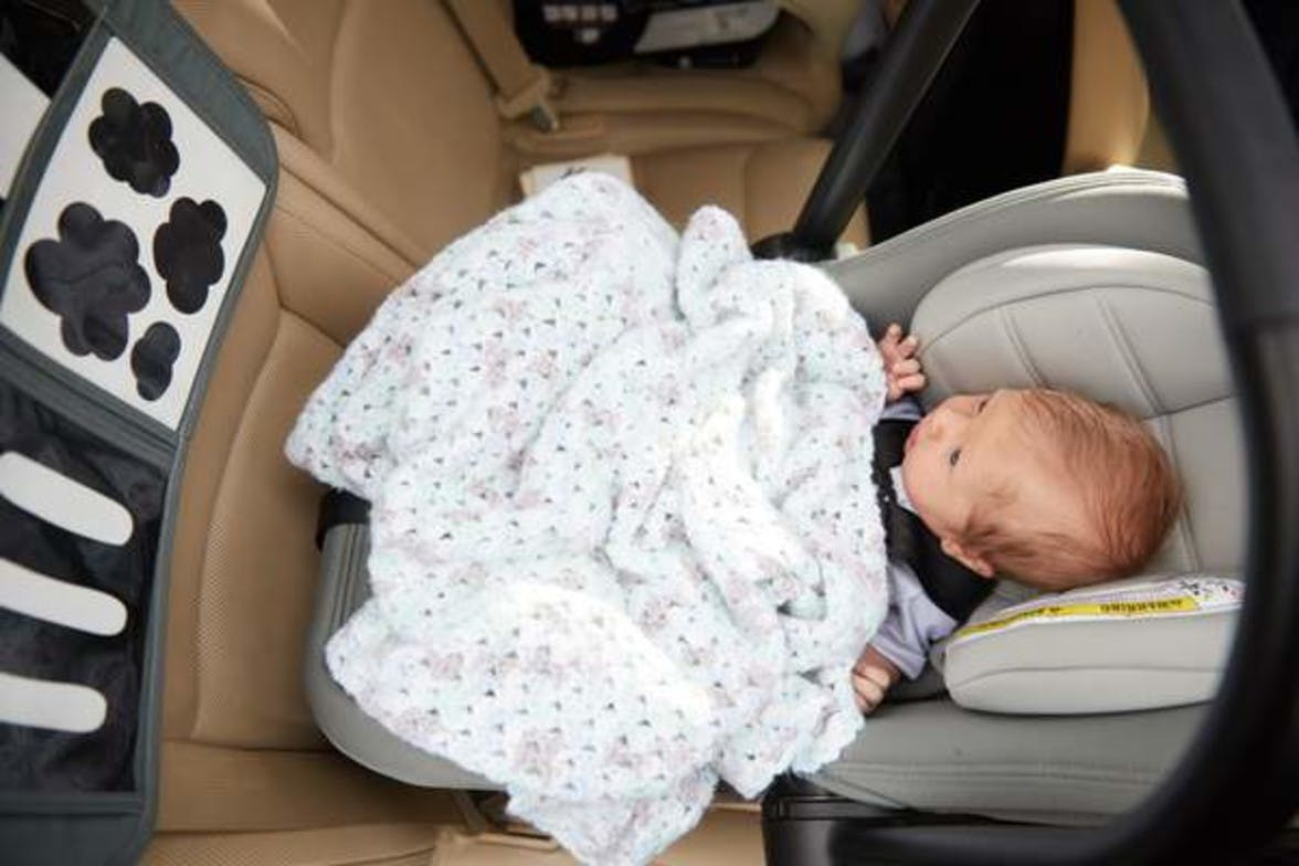 Baby sitting in their car seat looking at Black and White Contrast Cards by Lovevery