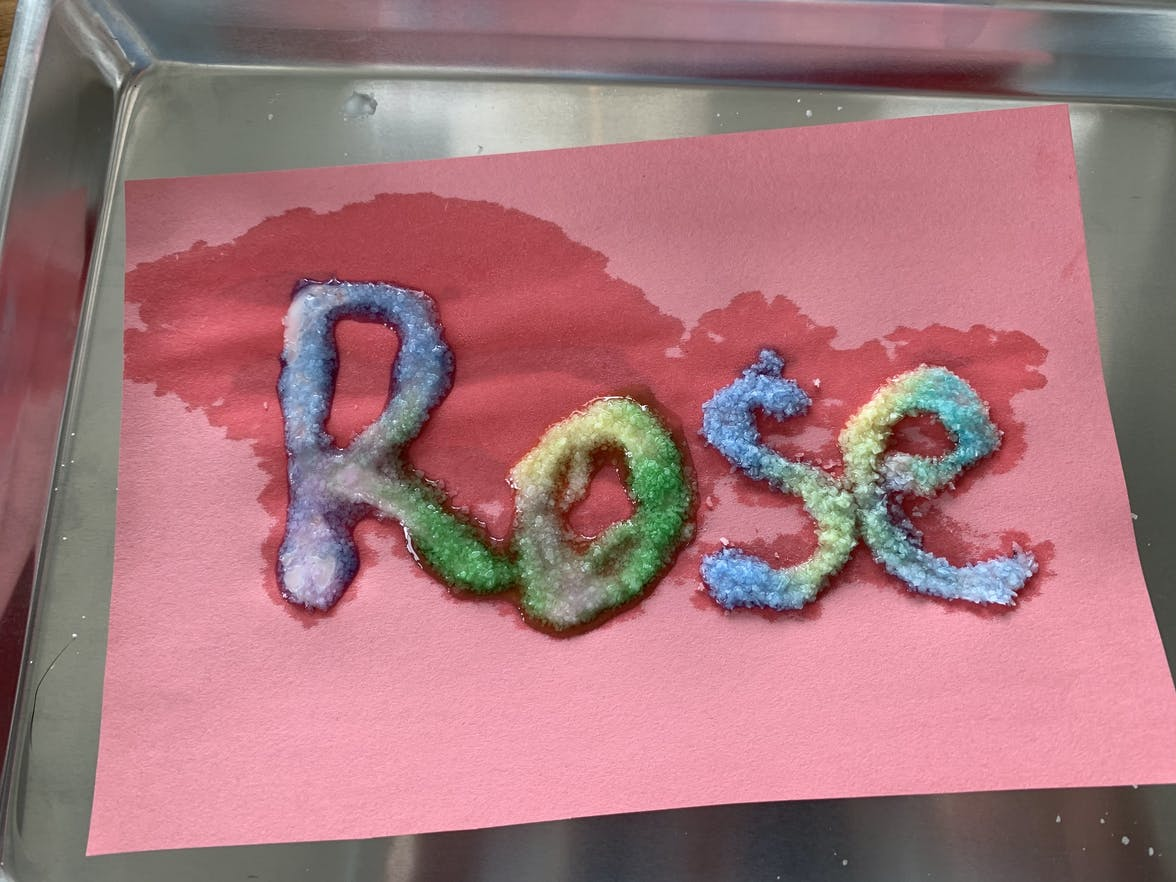The name Rose on a red piece of paper