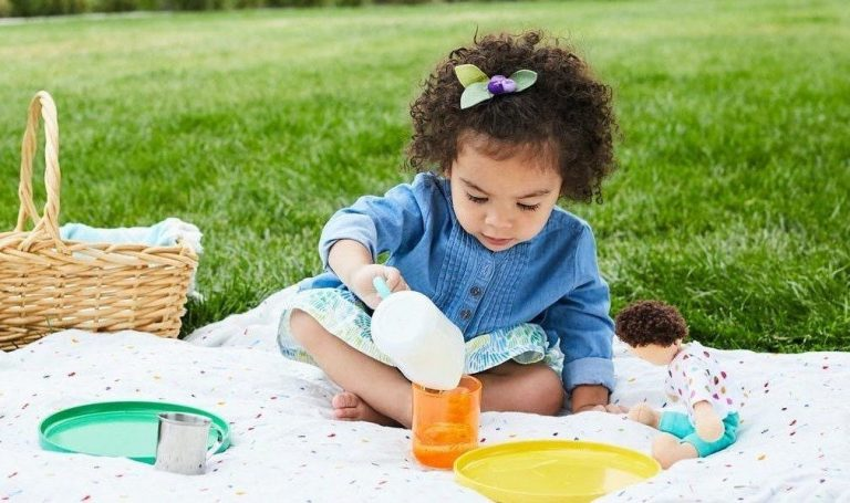 Toddler sitting outside having a picnic