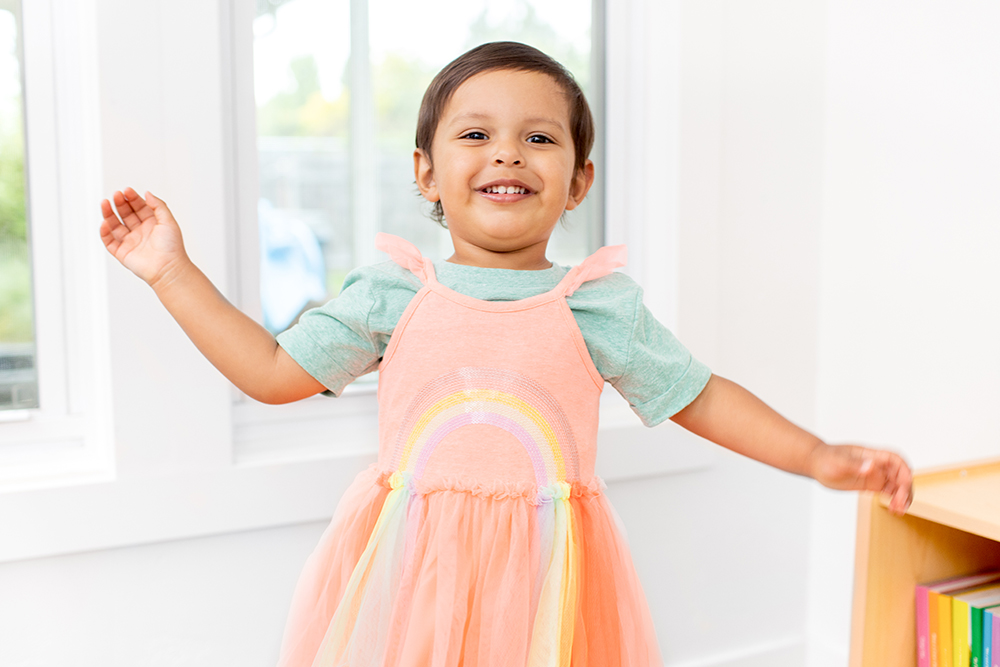 Young child wearing a colorful dress