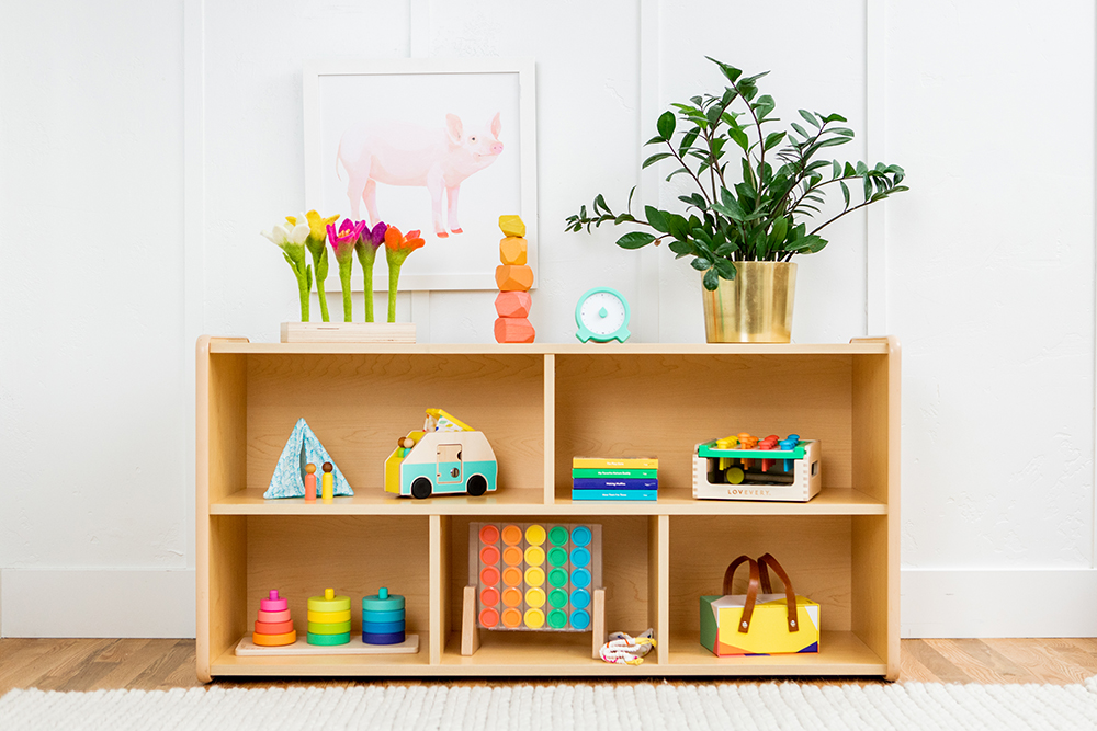 Shelf filled with the colorful wooden toys by Lovevery