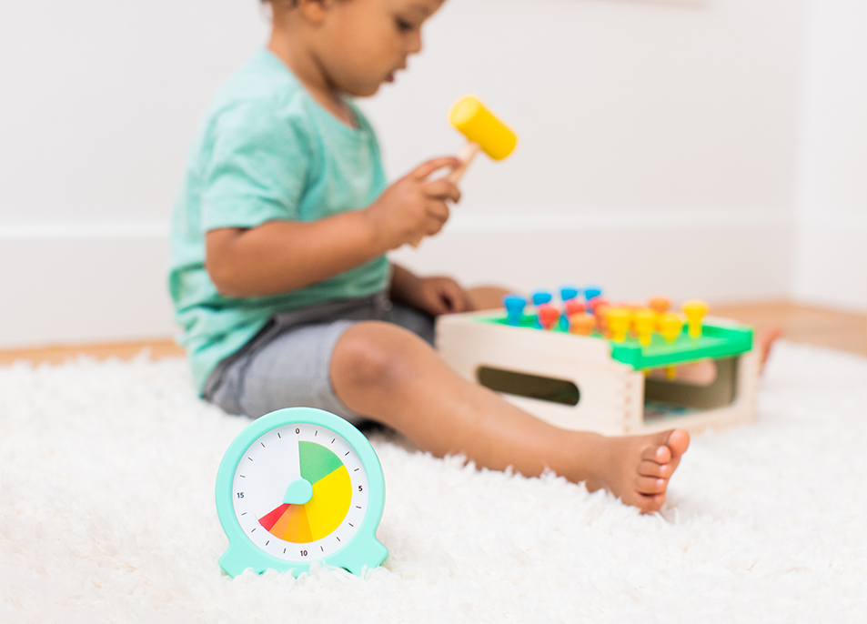 Toddler playing with the Match and Tap Hammer Box by Lovevery