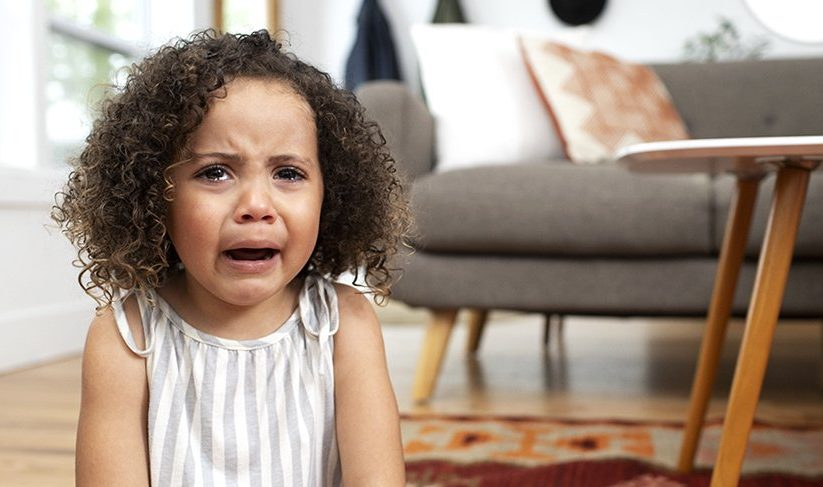 Young child crying and upset