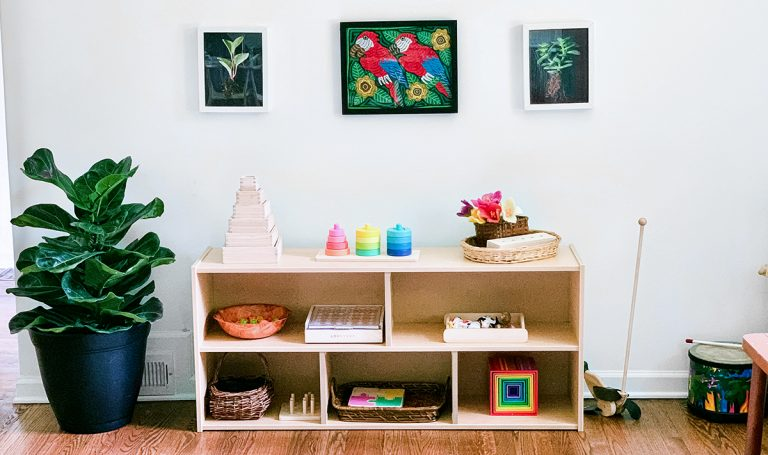 A wooden shelf filled with toys by Lovevery