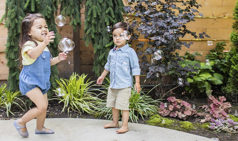Children play with bubbles.