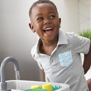 25-27 month old child playing with the sustainable sink by Lovevery
