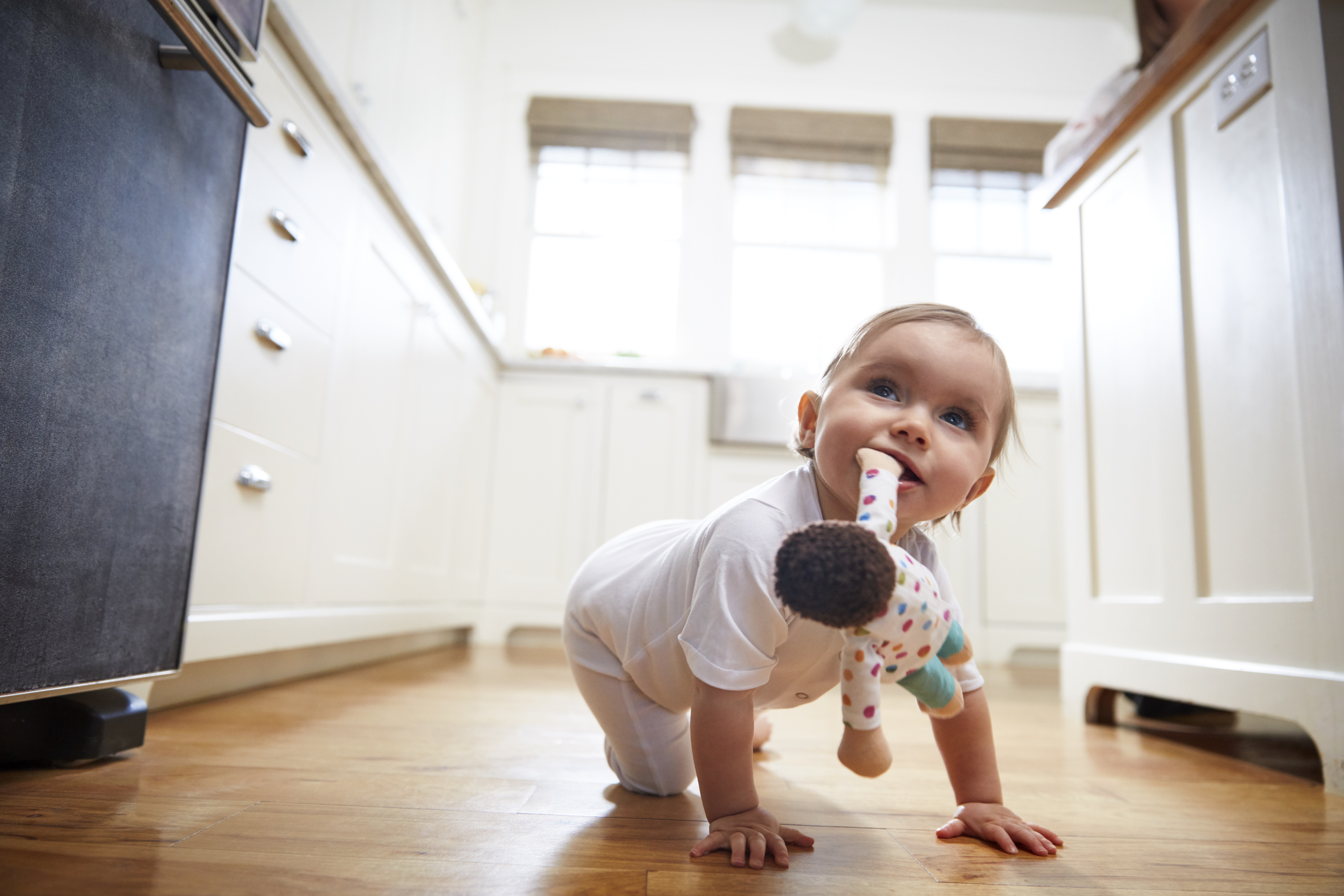 Toddler crawling with the Cotton Doll in their mouth