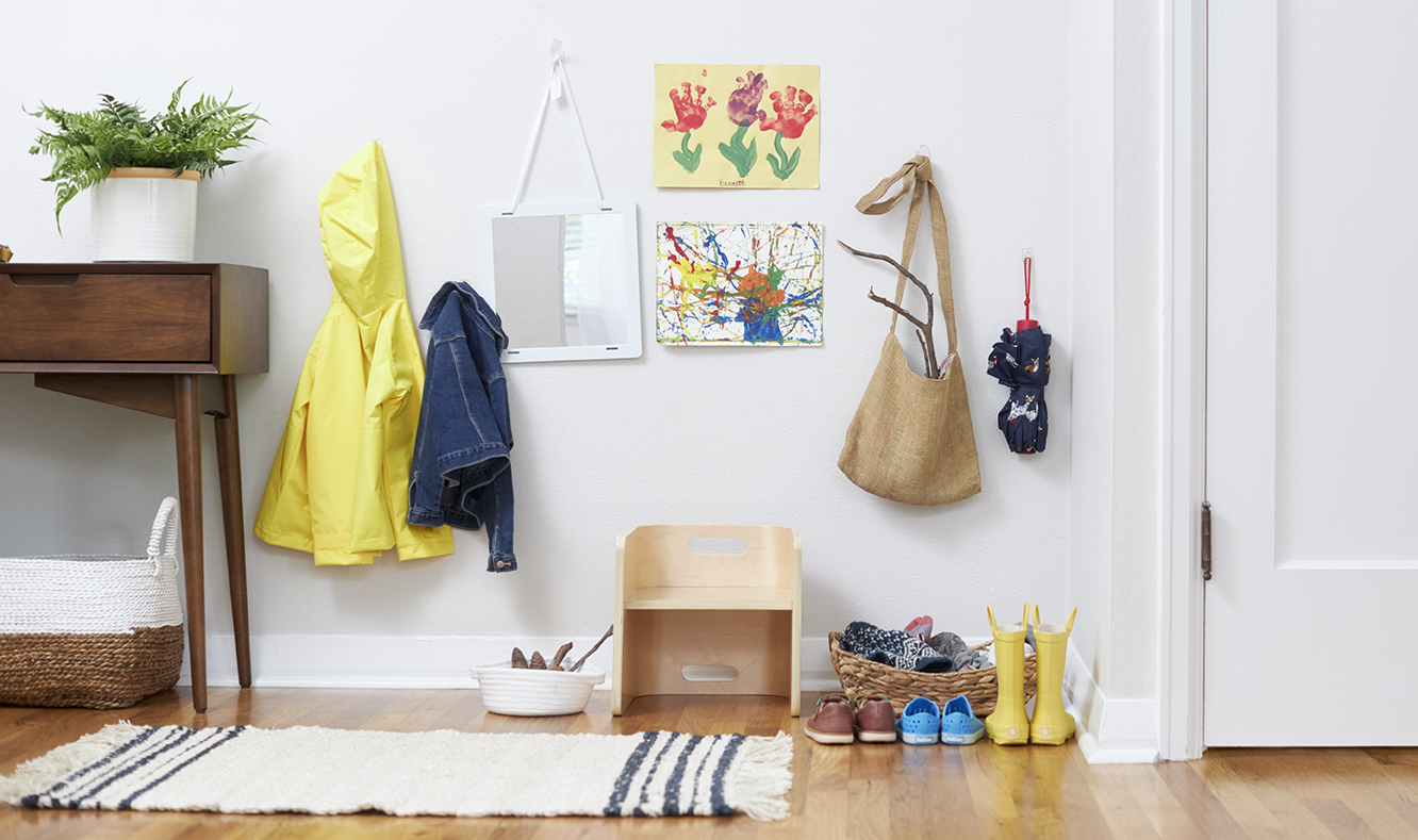 Organized spot by the front door with shoes, jackets, bags, etc.