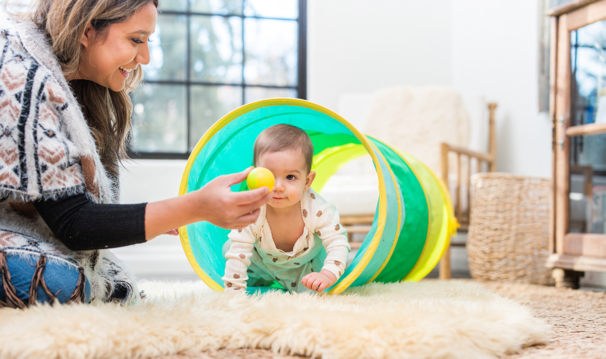 Baby crawling through the Play Tunnel by Lovevery