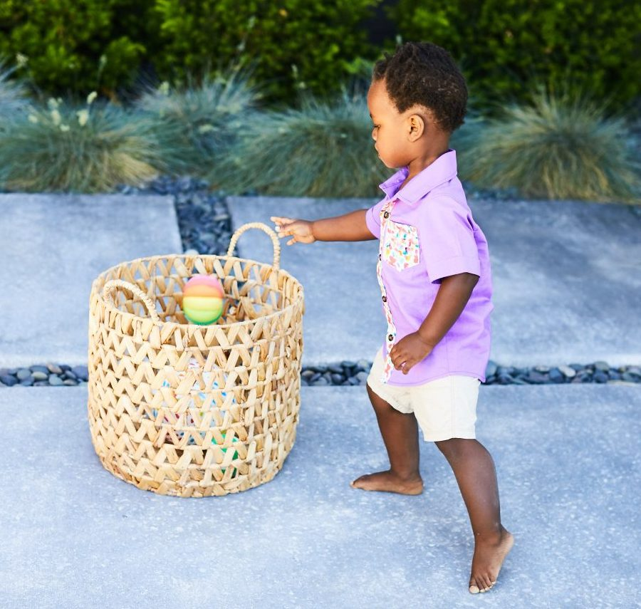 Toddler throwing the Montessori Ball by Lovevery