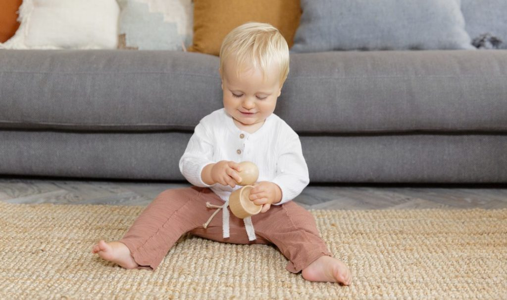 Child playing with the Lovevery Montessori egg