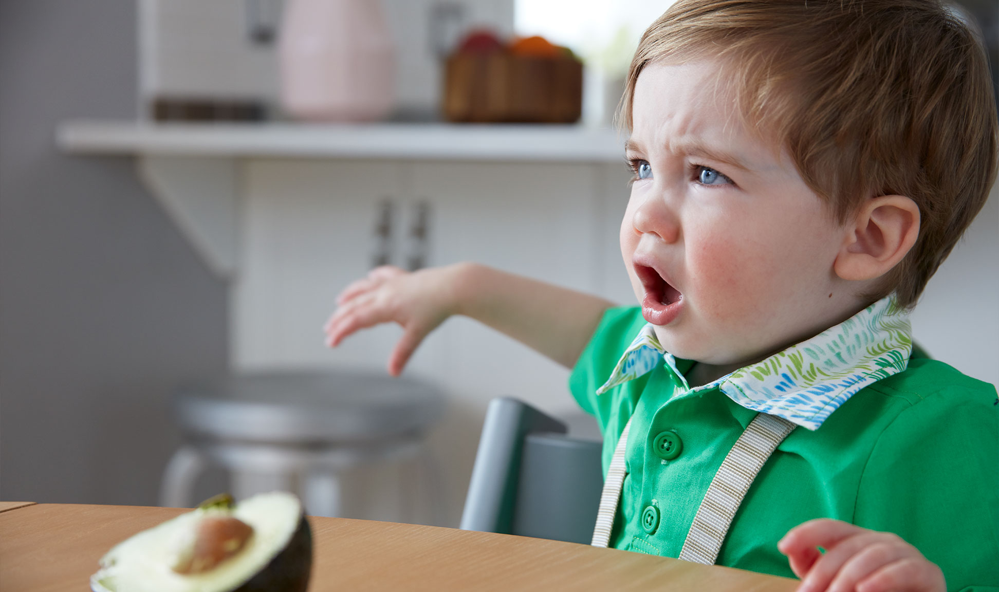 Child appears unhappy with the menu.