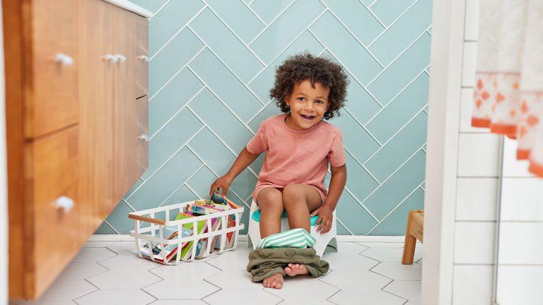 Child sitting on a potty.
