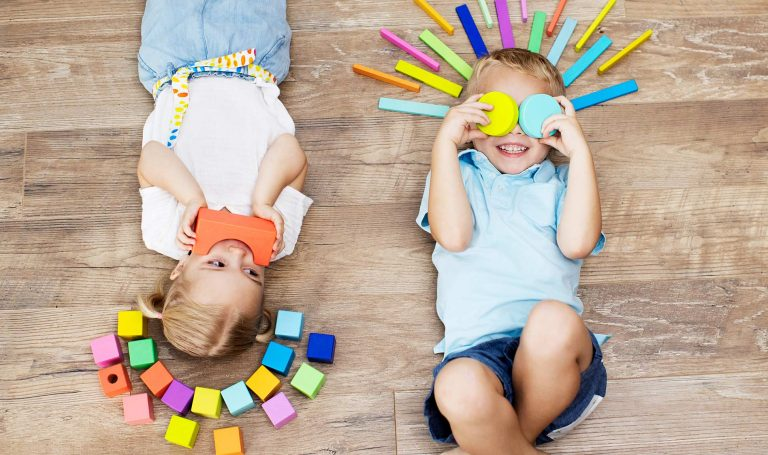 Children play with colorful blocks